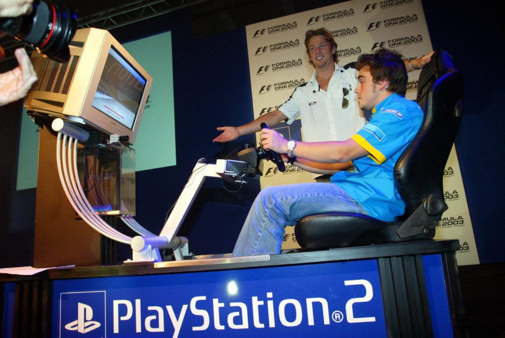 Fernando Alonso and Jenson Button have fun on a simulator for a Sony Playstation 2 Event © XPB Images