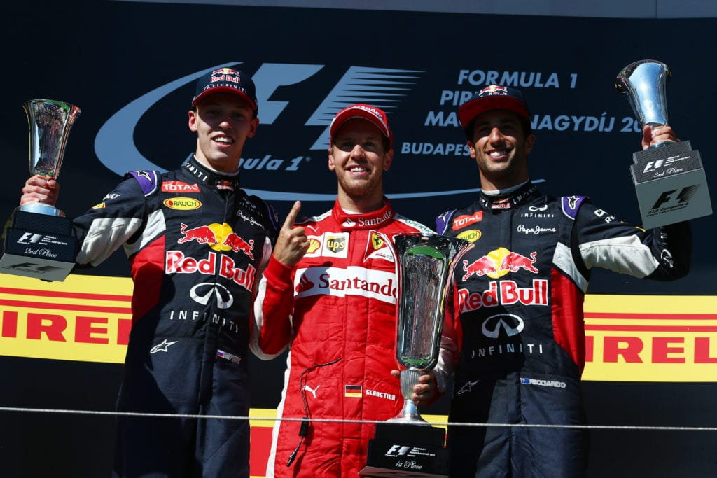 Red Bull Racing's Daniil Kvyat and Daniel Ricciardo share a podium at the 2015 Hungarian Grand Prix © XPB Images