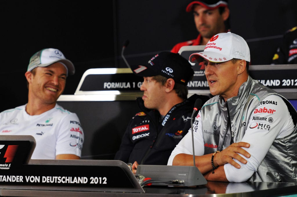 Rosberg laughs off the prank with Sebastian Vettel and Michael Schumacher © XPB Images