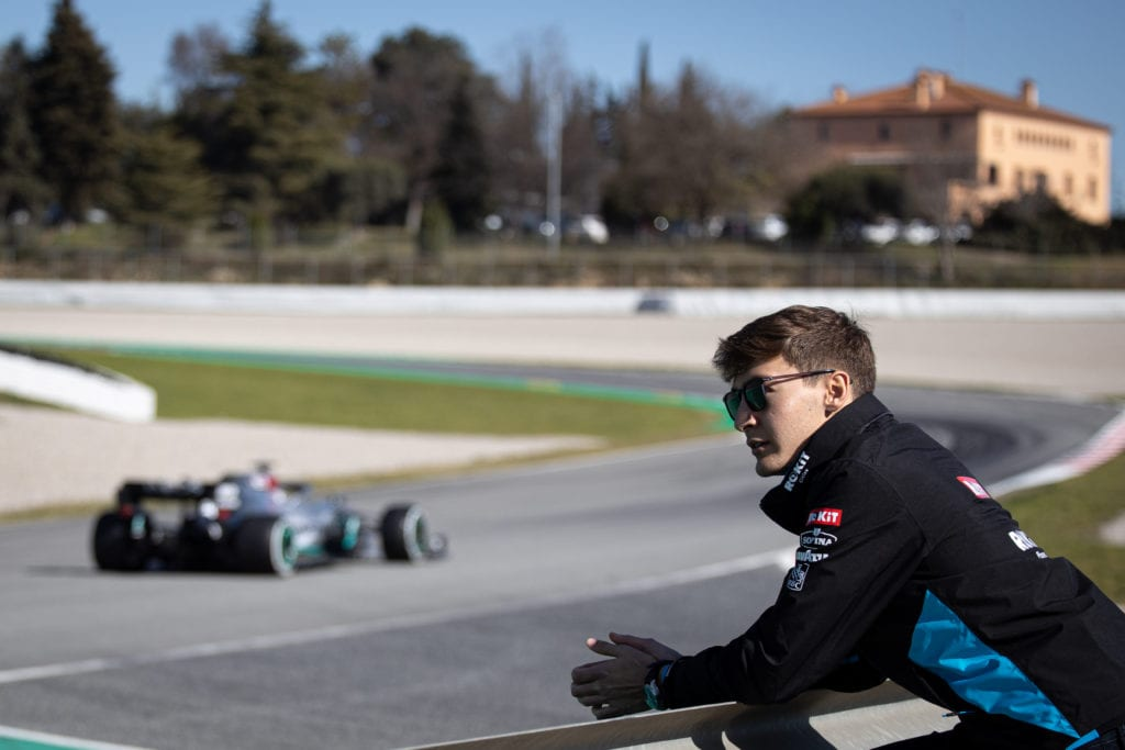 George Russell of Williams Racing watches Lewis Hamilton in his Mercedes © XPB Images